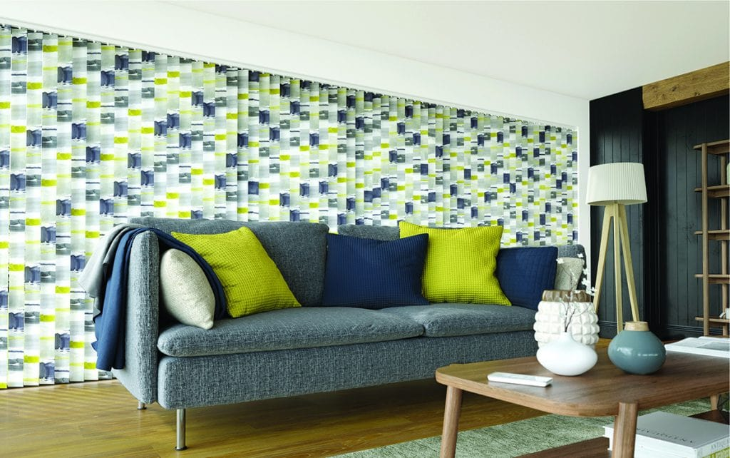 Vertical blinds made from Louvolite's Como Ocra fabric