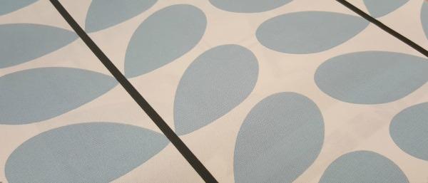 Pale blue Orla Kiely fabric close up