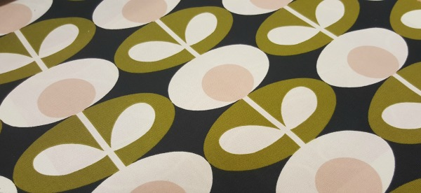 Close up lime, cream and blue Orla Kiely curtain fabric