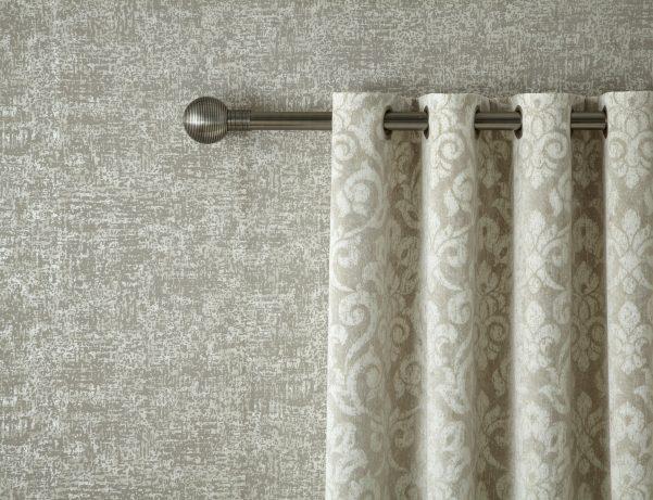 metallic curtain pole and close up of cream curtain
