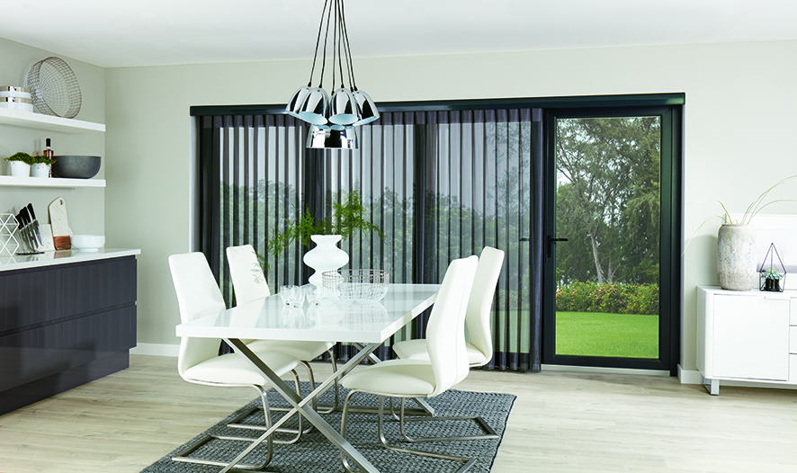 Pewter coloured Allusion blinds on patio bi-fold doors