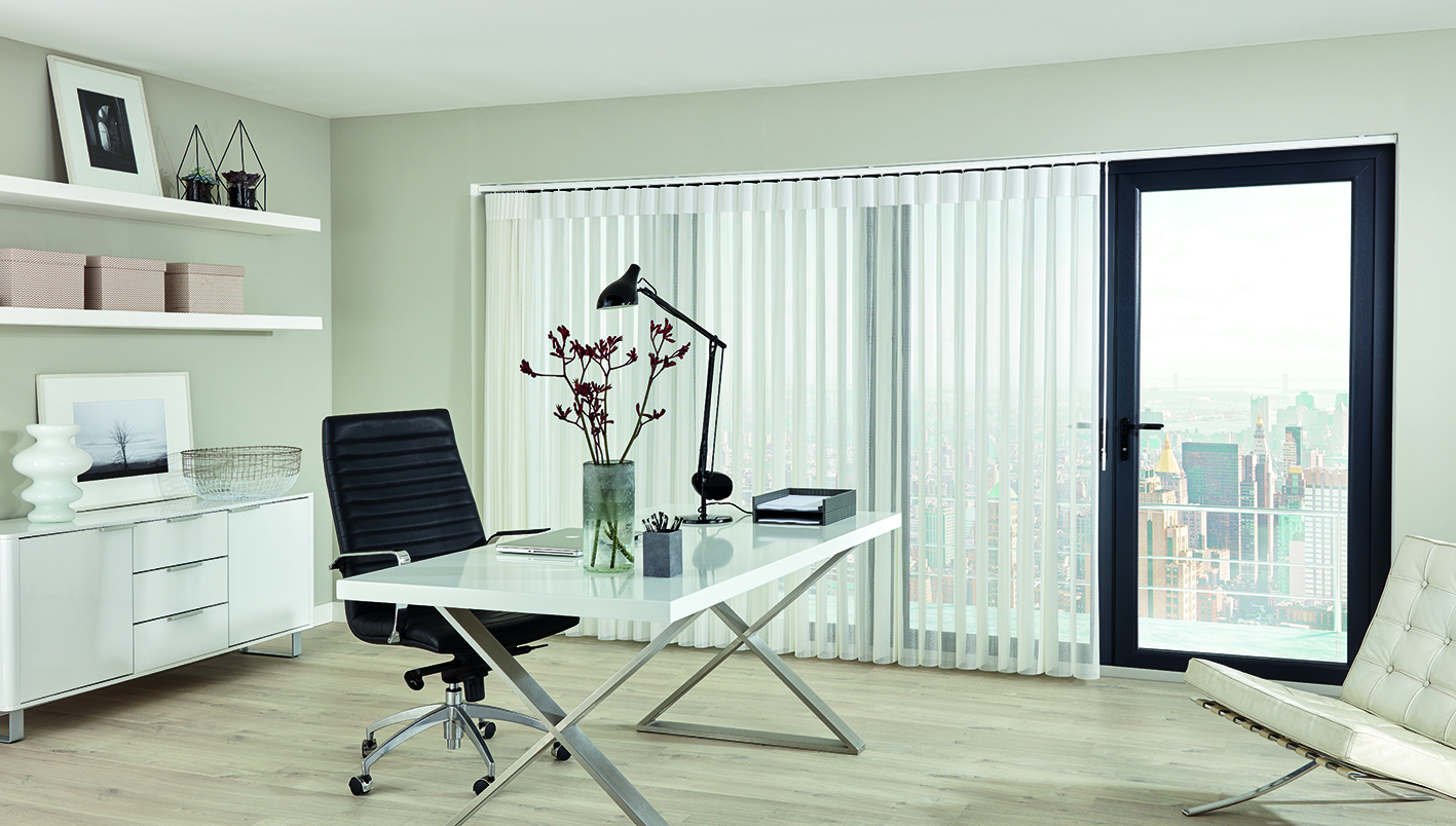 Office blinds. Cream Allusion blinds in large office window.