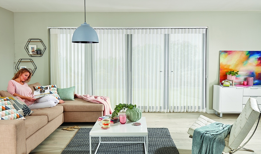 White Allusion blinds in living room closed but with louvres rotated to allow in filtered light