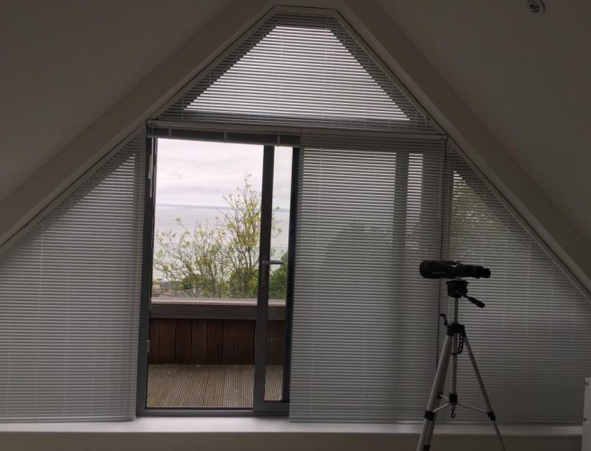 Blinds fitted for a triangular window