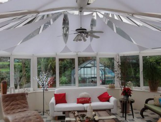 Geargeoura sails fitted to the ceiling of a conservatory