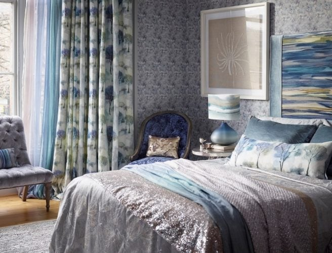 Delicate tree pattern in blue and grey on cream background in bedroom curtains