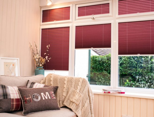 Red Pleated perfect fit blinds in the lounge