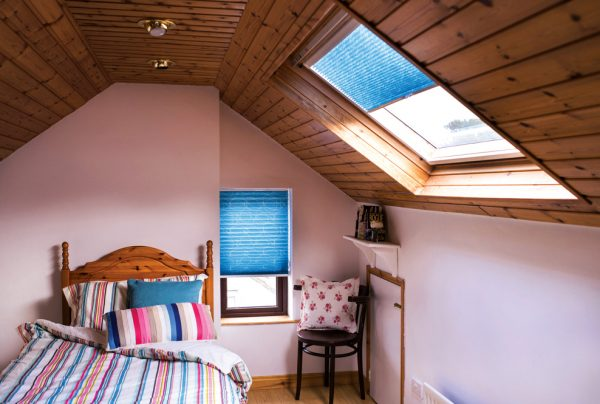 Pleated blinds in an attic bedroom.