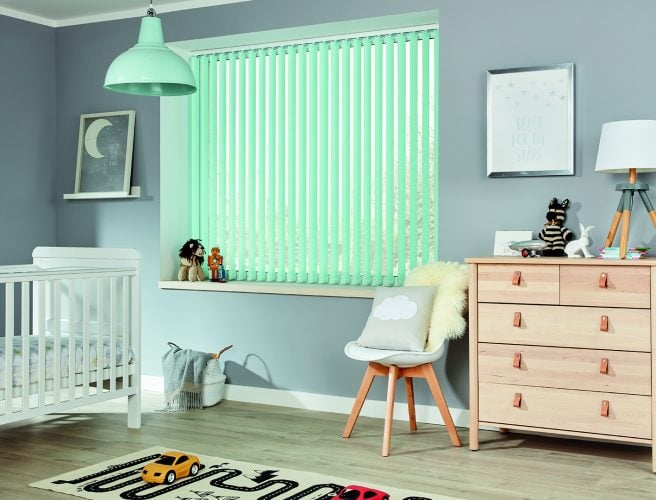 Aqua coloured vertical blackout blinds in a child's bedroom