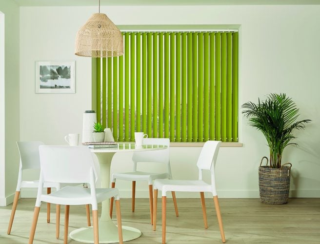 Bright green vertical blinds in modern dining room