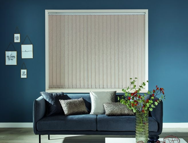 Taupe vertical blinds in a living room with contrasting blue walls