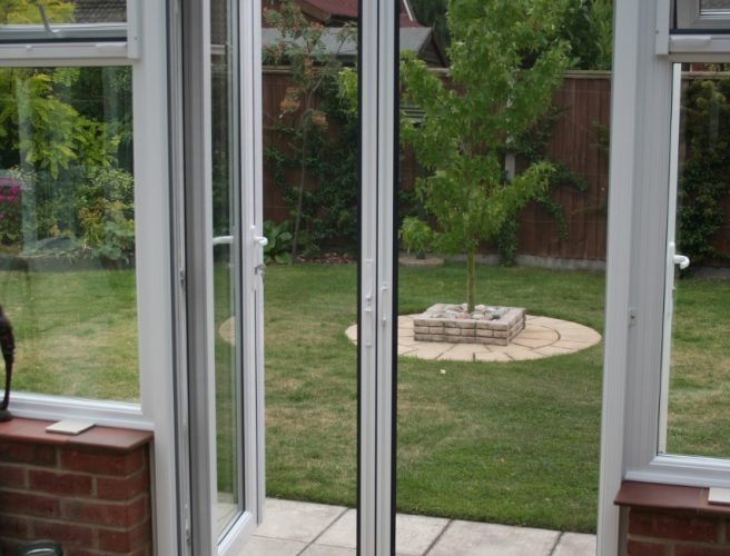 Flyscreens norwich sunblinds for Roller fly screens for patio doors