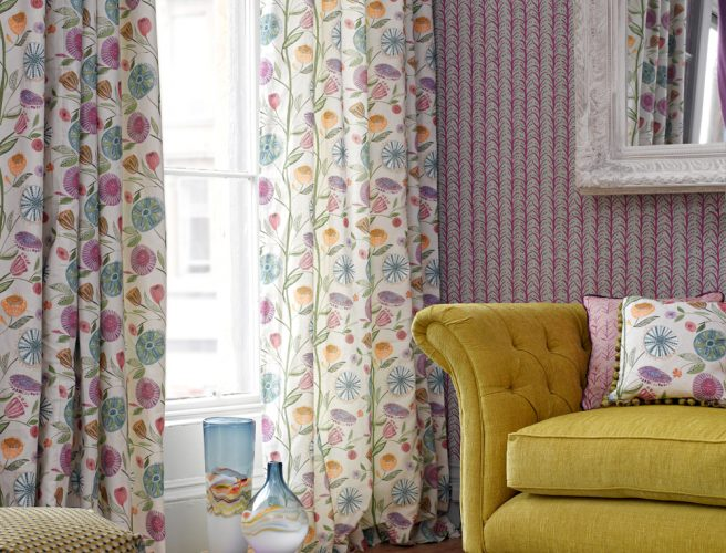 Curtains for the lounge in Myanmar fabric with multi-coloured designs on cream background