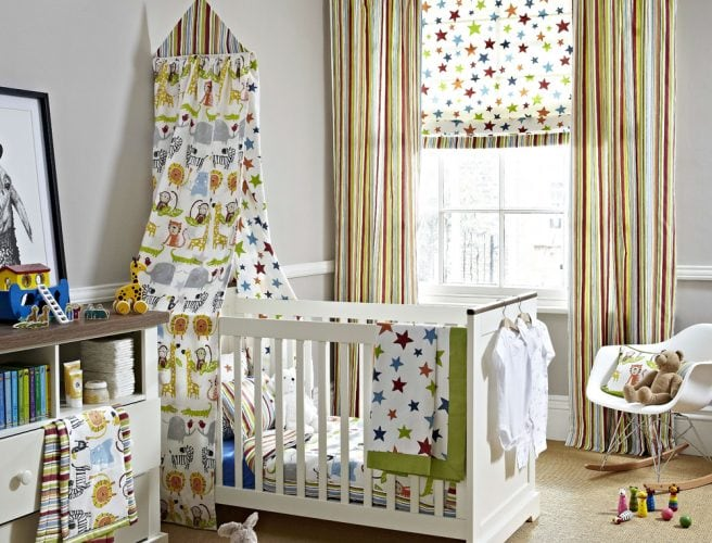 Childrens bedroom with Playtime fabric curtains and blinds with star, stripe and animal prints from Prestigious