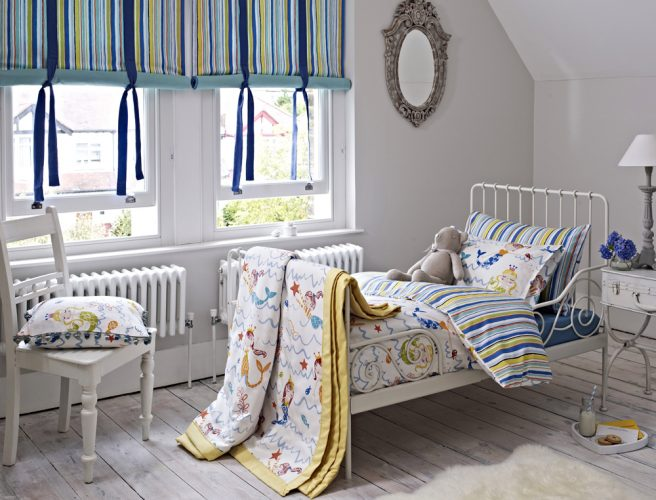 Roman blinds for childrens bedroom with Playtime fabric from Prestigious