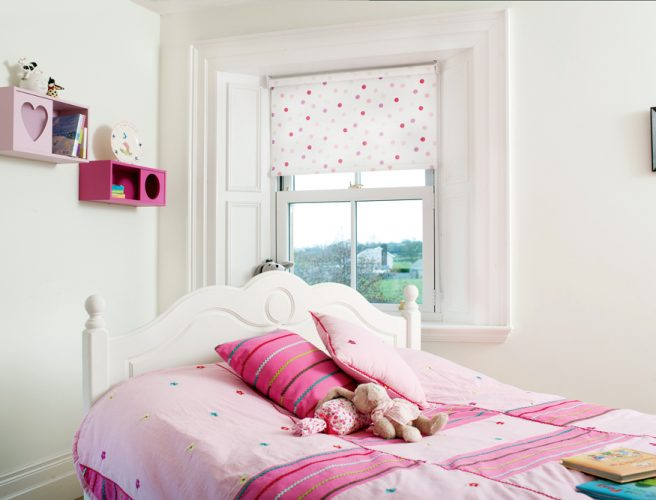 Pastel pink pattern on a white background in a child's bedroom