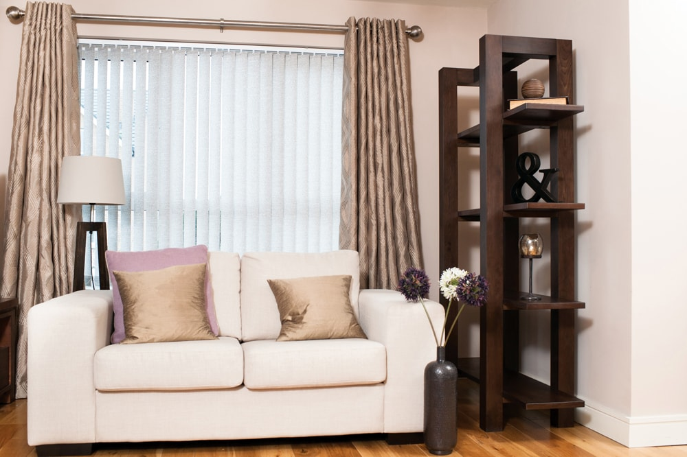 Cream vertical blinds for the lounge teamed with full length curtains - an alternative to net curtains