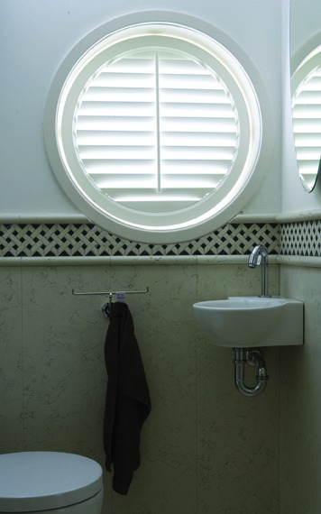 Porthole shaped white shutter in bathroom - Shutters Norfolk - Norwich Sunblinds