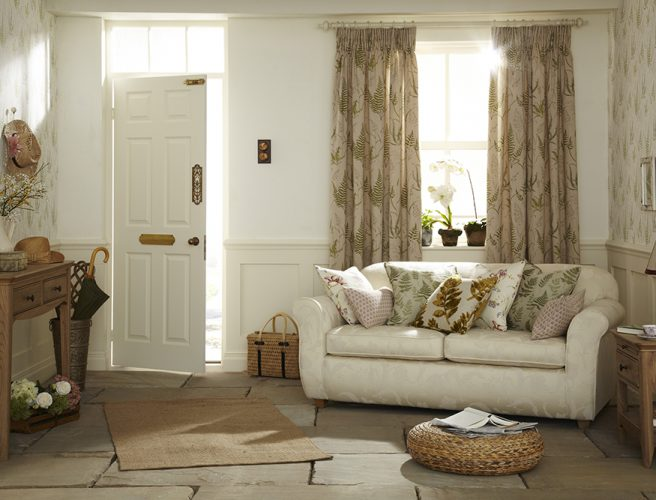 Soft red botanica fabric with fern design in living room curtains.