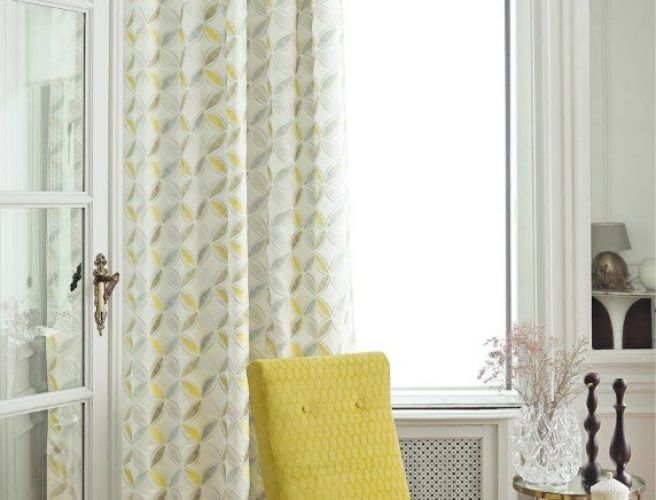 Casadeco Petale Jaune curtain fabric lime and grey on a cream background