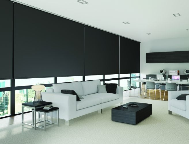 black roller blinds in large windows in modern office - Blinds Norfolk - Norwich Sunblinds