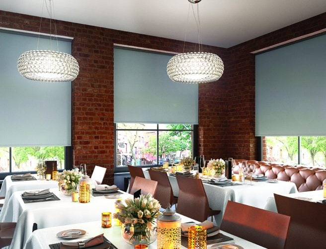 Grey roller blinds in a restaurant - Blinds Norfolk - Norwich Sunblinds