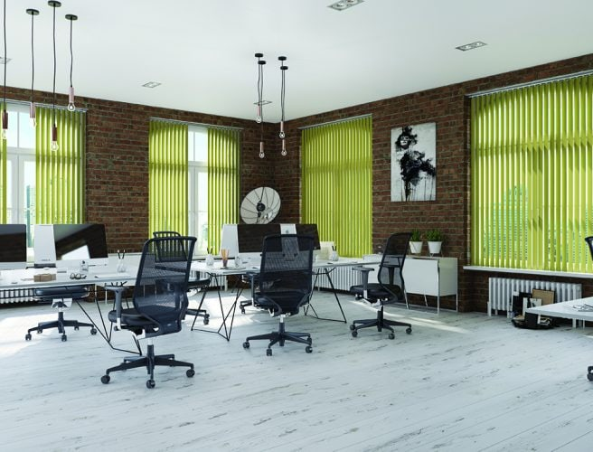 Green vertrical blinds in modern office in converted building
