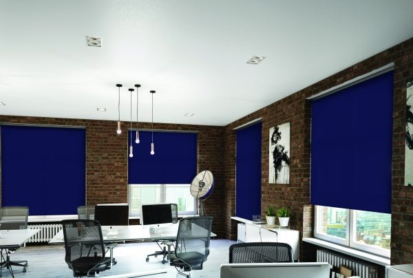 Saffire coloured roller blinds in an office / boardroom setting