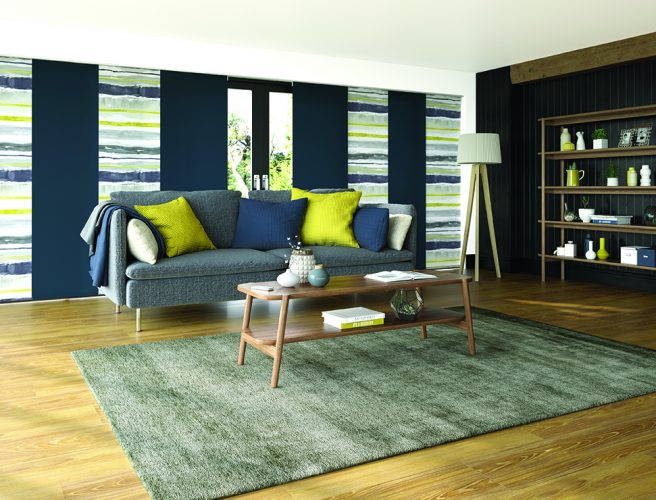 Panel blinds for the lounge in alternate navy and como ocra horizontal striped fabric
