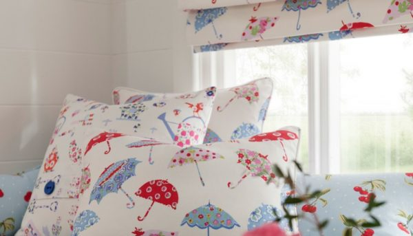 Matching cushions and roman blinds made from Clarke & Clarke Blighty fabric with Pink, red and blue umbrella designs on cream background - Blinds Norfolk - Norwich Sunblinds