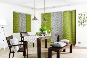Vertical blinds made from contrasting Paradise Chartreuse and Paradise Silver fabric from Louvolite.