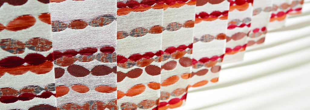 Vertical blinds made from Pebbles Rumba Red fabric