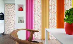 Combination of Tropicana Singapore Sling, Carnival Coral, and Canteloupe fabric in vertical blinds