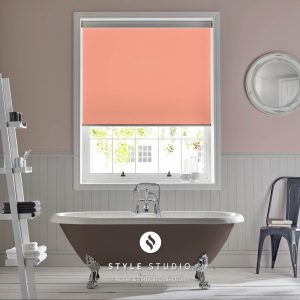 Bathroom roller blind with coral coloured fabric