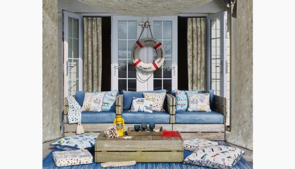 Nautical themed cushions and curtains.