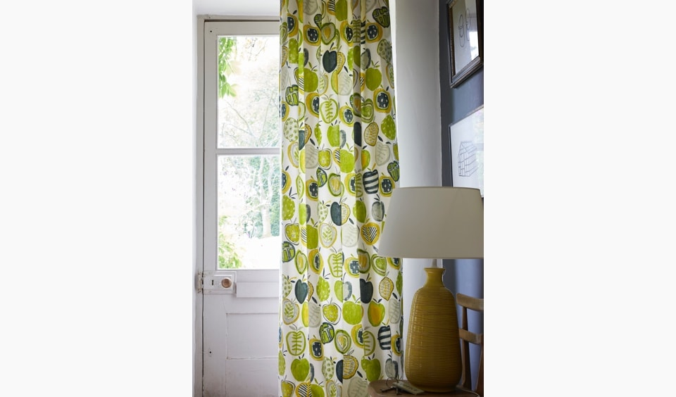 Lime green leaf patterned doorway curtains