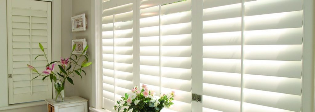 close up of white bedroom shutters