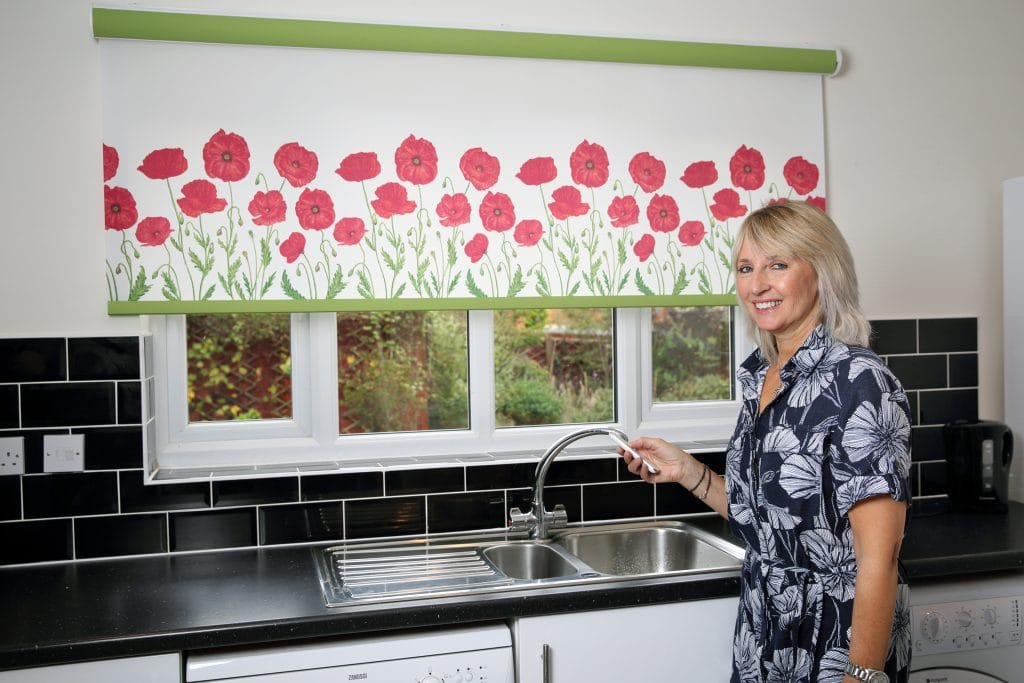 Poppy design motorised kitchen roller blind