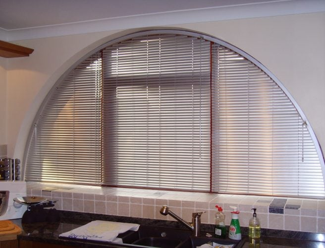 Curved kitchen window with tailor made fitted blinds