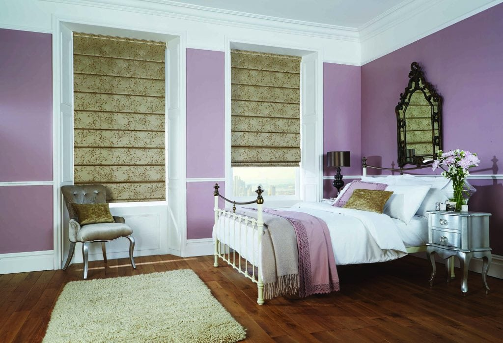 Antique gold Roman blinds in the bedroom