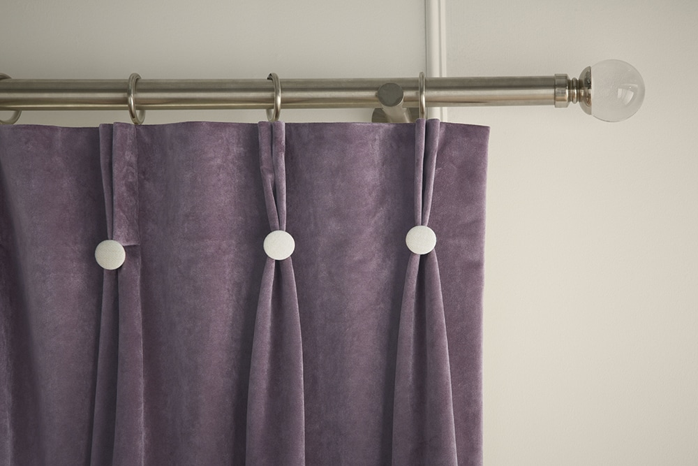 Close up of stylish curtains in pale amethyst hues, fabric by iLiv