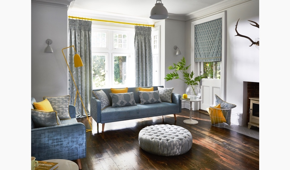 Grey living room curtains with yellow curtain pole