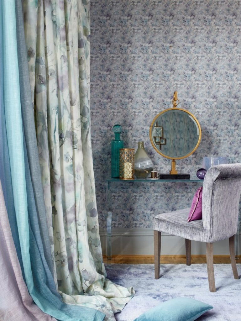 Delicate patterned curtains in hues of blue, brown and green