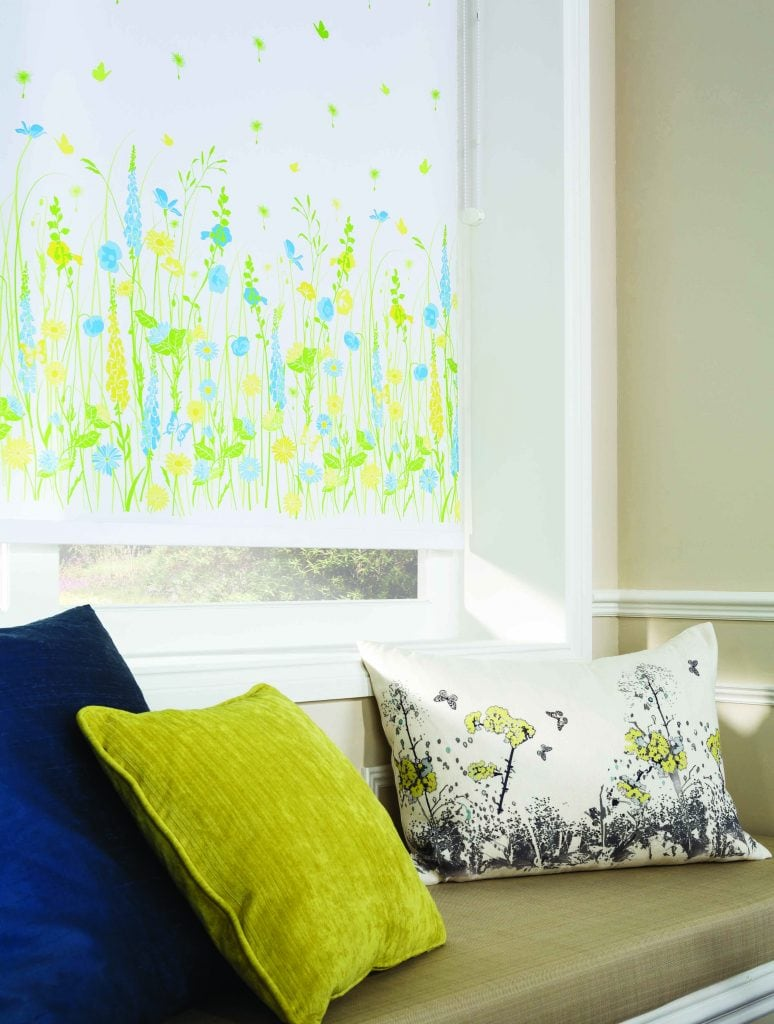 Yellow and blue flowers on a white background roller blind