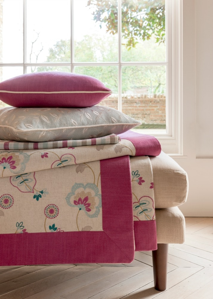 Pink and cream cushions and bedspread/ throw