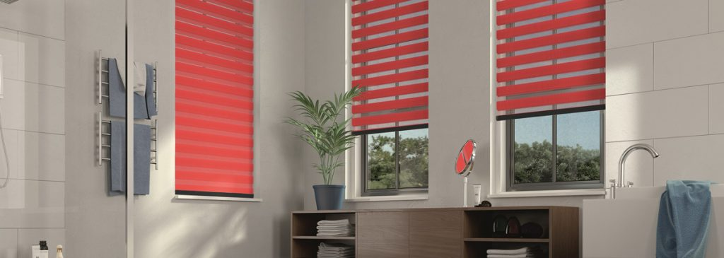 Motorised bathroom roller blind in red