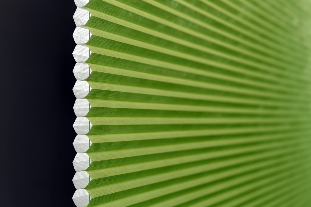 Close up image of Lime green pleated blinds