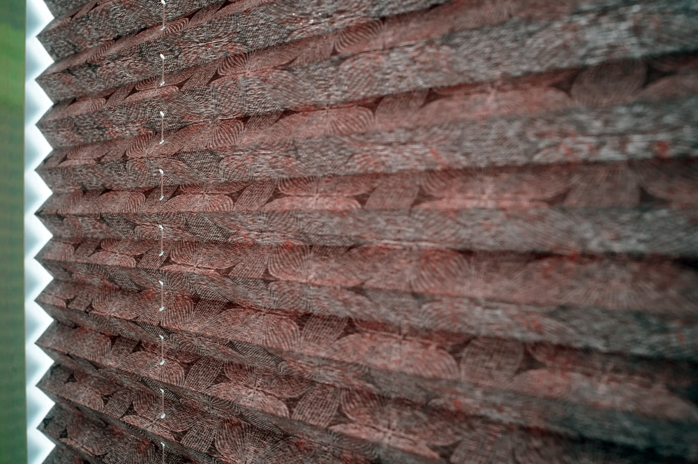 Close up of textured brown pleated blinds