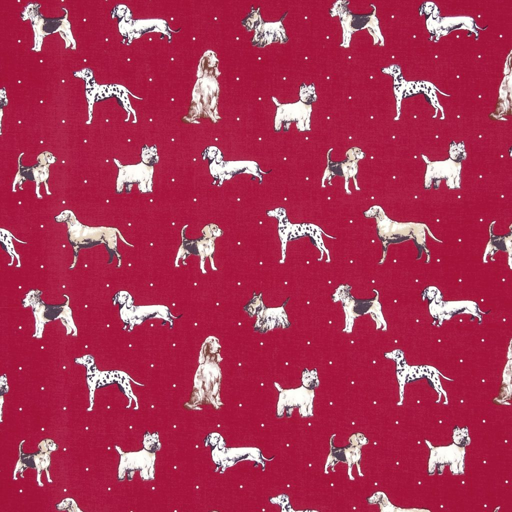 Fabric swatch showing dog images on red background