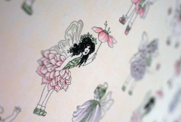 Purple Flower fairies with cream background in close up image of roller blind
